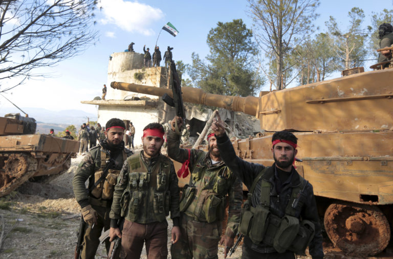 Fighting flares up on hill Turkey seized in Syria offensive