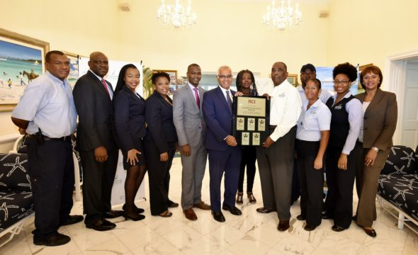 Minister D'Aguilar celebrates Sandyport Beach Resort's TripAdvisor and RCI Top Awards
