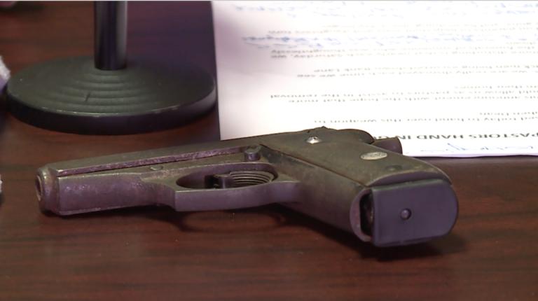 Bishop Hall hands over gun