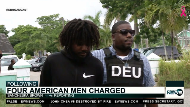 4 Americans charged in court