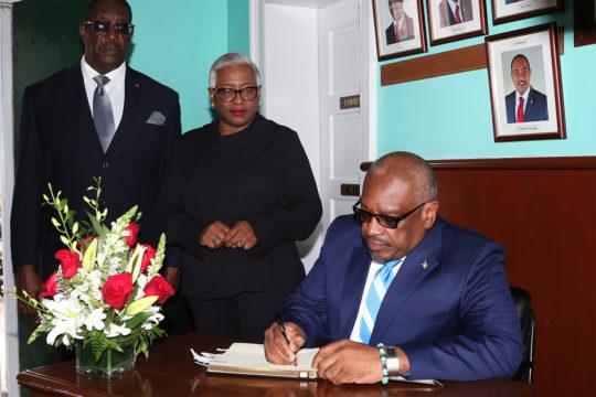PM signs book of condolence