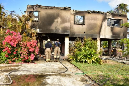 Two die in building engulfed in flames on GB