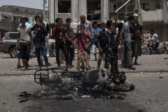 Rebel missile, suicide attack kill dozens in Yemen's port
