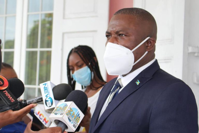 Wells defends appointment as health minister