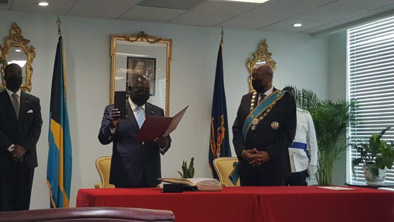 TAKING THE OATH OF OFFICE: Philip Brave Davis sworn in as PM in private ceremony